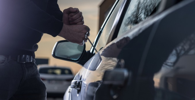 auto-thief-trying-to-break-into-car